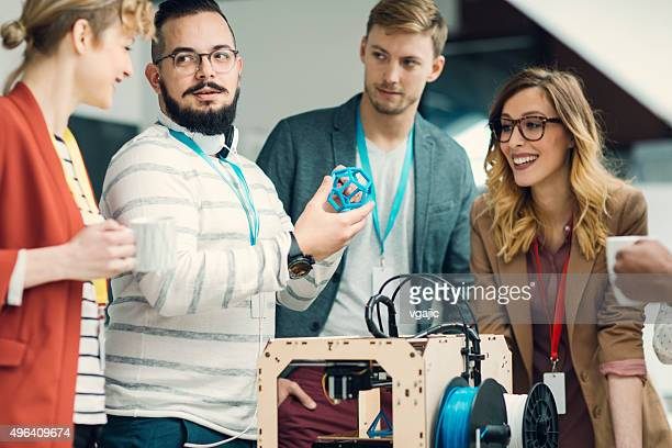 Young Creative Business People Working by 3D Printer.
