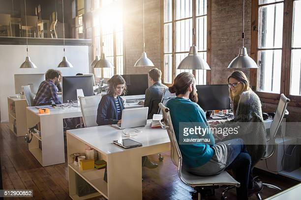 Young creative business people working in the office