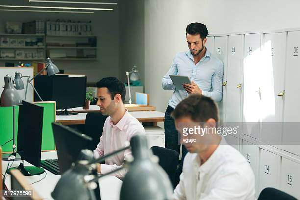 Young Creative Business People Working In Their Office.