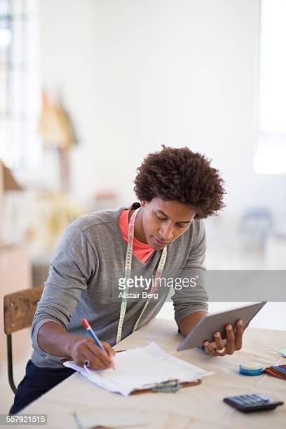 Young creative designer in his studio