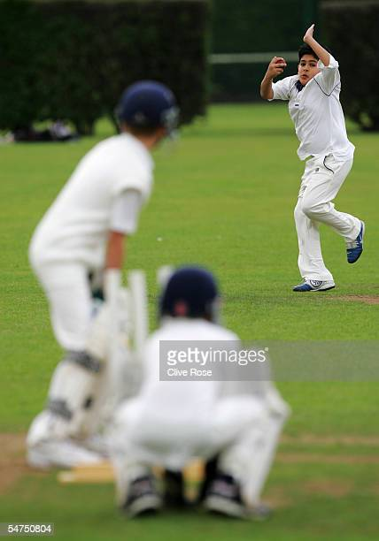 A young cricketer bowls at The Spencer Club on August 14 2005 in London