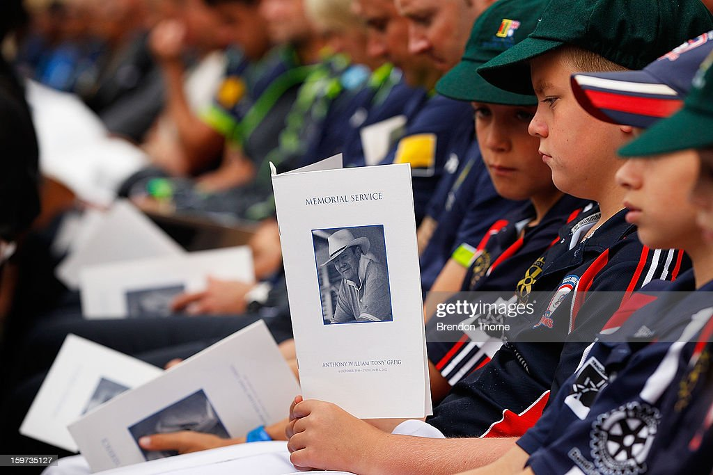 Young cricketers hold a memorial service booklet during the Tony Greig memorial service at Sydney Cricket Ground on January 20, 2013 in Sydney, Australia.