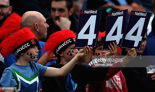 Young crickeyt supporters signal four runs during the NatWest T20 Blast match between Leicestershire and Derbyshire at Grace Road on May 22 2015 in...