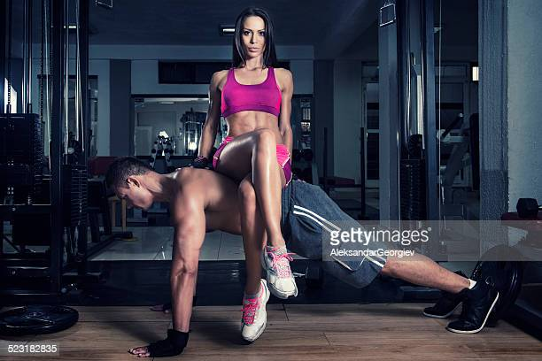 Young Crossfitter Couple Exercise in the Gym