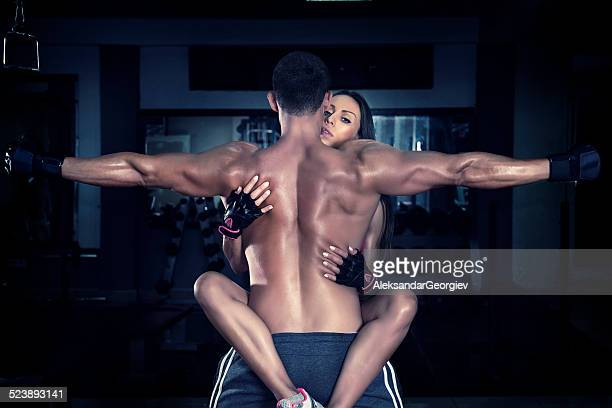 Young Crossfitter Couple Kisses in the Gym During Exercise.