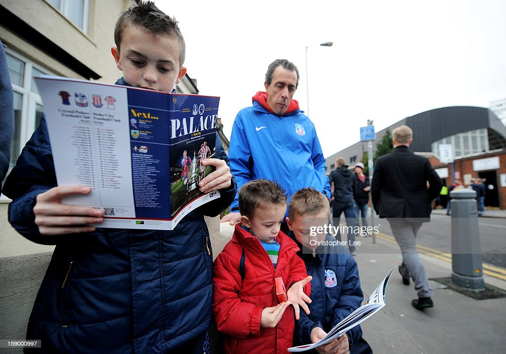 Young Crystal Palace fans read their match programmes prior to the FA Cup with Budweiser Third Round match between Crystal Palace and Stoke City at Selhurst Park on January 5, 2013 in London, England.