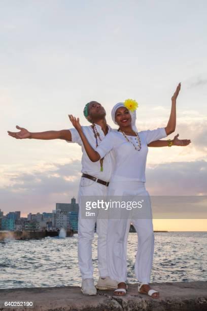 Young Cuban couple at sunset, Malecon, Havana, Cuba