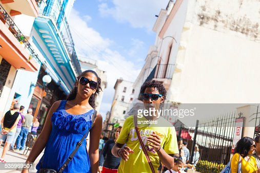 Young Cuban Couple in Calle Obispo, Havana old town : Stock Photo