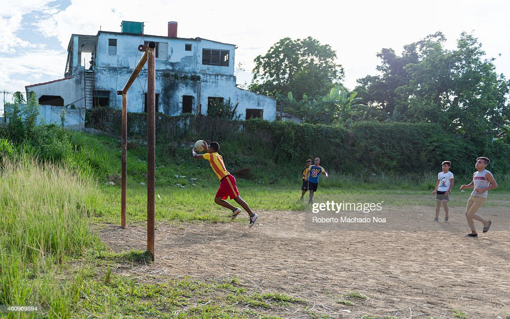 Young Cuban people playing soccer in an abandoned field. The practice of sports is widespread in the island due to high educational levels so youth enjoy practicing sports.