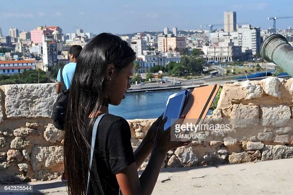 A young Cuban reads on her tablet during the XXVI Edition of Havana's International Book Fair on February 13 2017 Despite an outofdate books market...