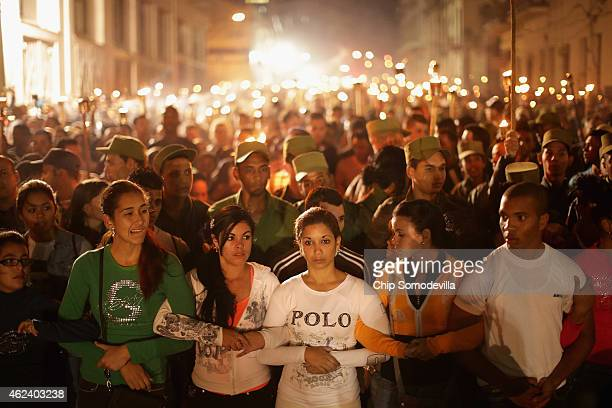 Young Cuban students walk arminarm during the March of the Torches from the University of Havana through the Vedado districts and to the Malecon...