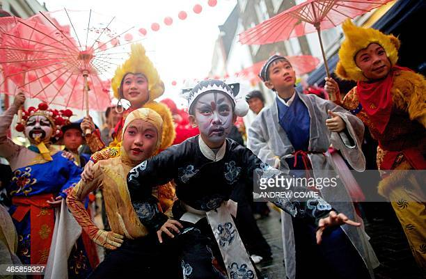 Young cultural ambassadors from Beijing dressed in traditional clothes pose for pictures during a photocall in the heart of London's Chinatown on...