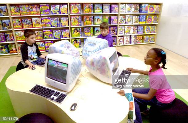 Young customers at Apple retail store which Apple opened to provide direct sales to consumers of Apple and associated products