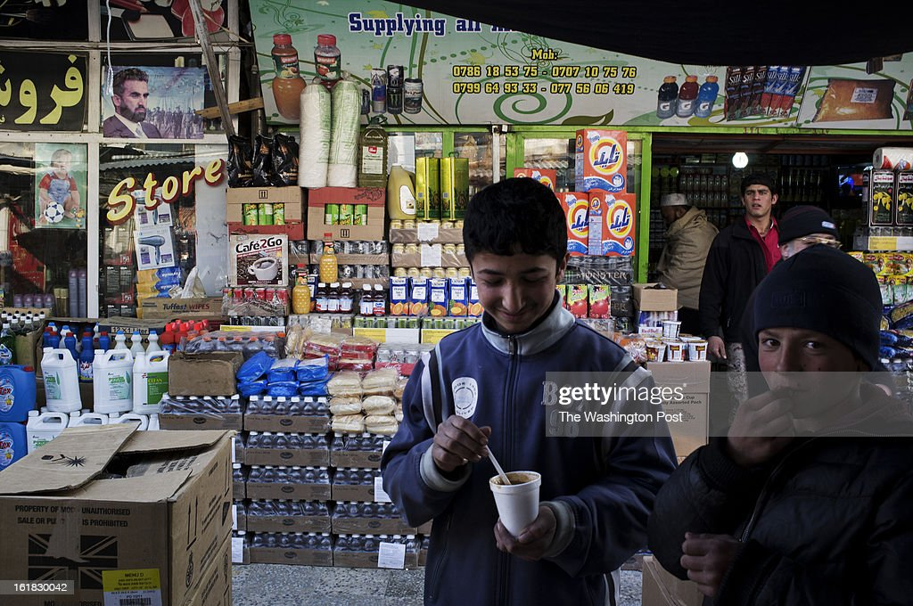 Young customers browse the stalls of Bush Market on a Friday afternoon. If a case of soap is pilfered from a U.S. military base here or pinched from a NATO shipping container, it will probably, sooner or later, end up for sale in the Bush Market, a sort of thieves' outlet mall in central Kabul. Named after the former U.S. president who launched the war in Afghanistan, the bazaar has flourished for more than eight years, thanks to the long presence of foreign troops that provided war booty aplenty. But in the Obama era, with its steady withdrawal of U.S. forces, the good times are ending.