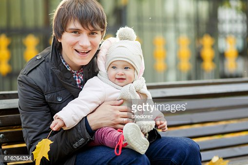 Young dad with little daughter in autumn park : Stock Photo