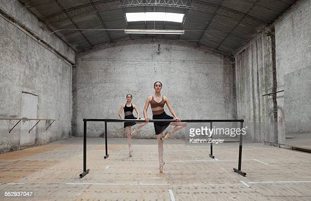 young dancers exercising in rehearsal room