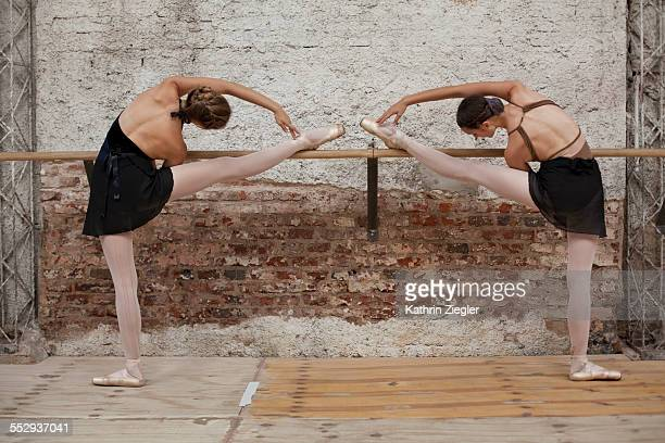 young dancers warming up at the barre