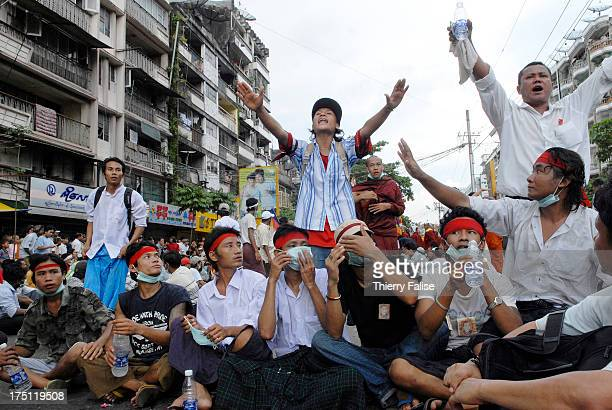 Young demonstrators at the front of a massive demonstration against the military junta Tens of thousands of monks demonstrated in Myanmars main...
