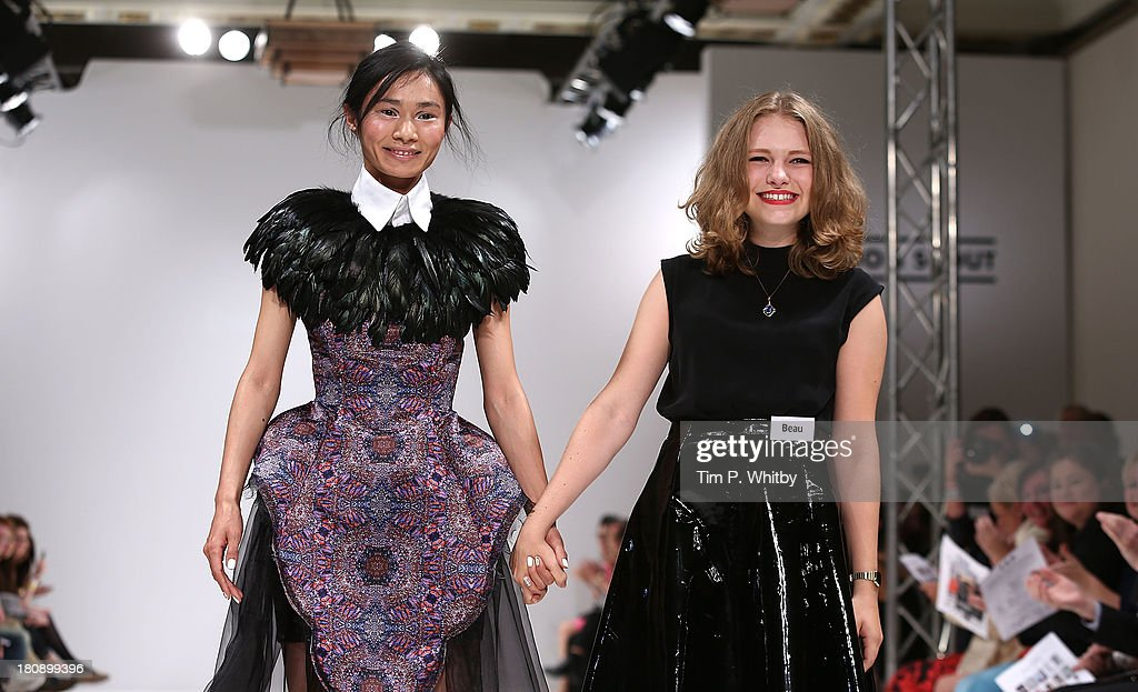 Young designer Beau Scarlett Pitt (right) with a model showing her winning design on the runway at the FAD show at the Fashion Scout Venue during London Fashion Week SS14 at Freemasons Hall on September 17, 2013 in London, England.