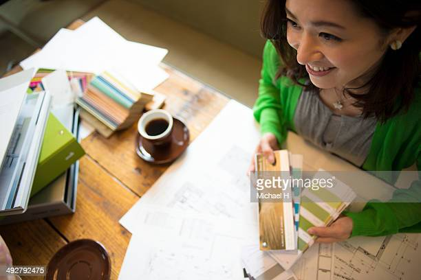 young designer discussing with custmer in cafe