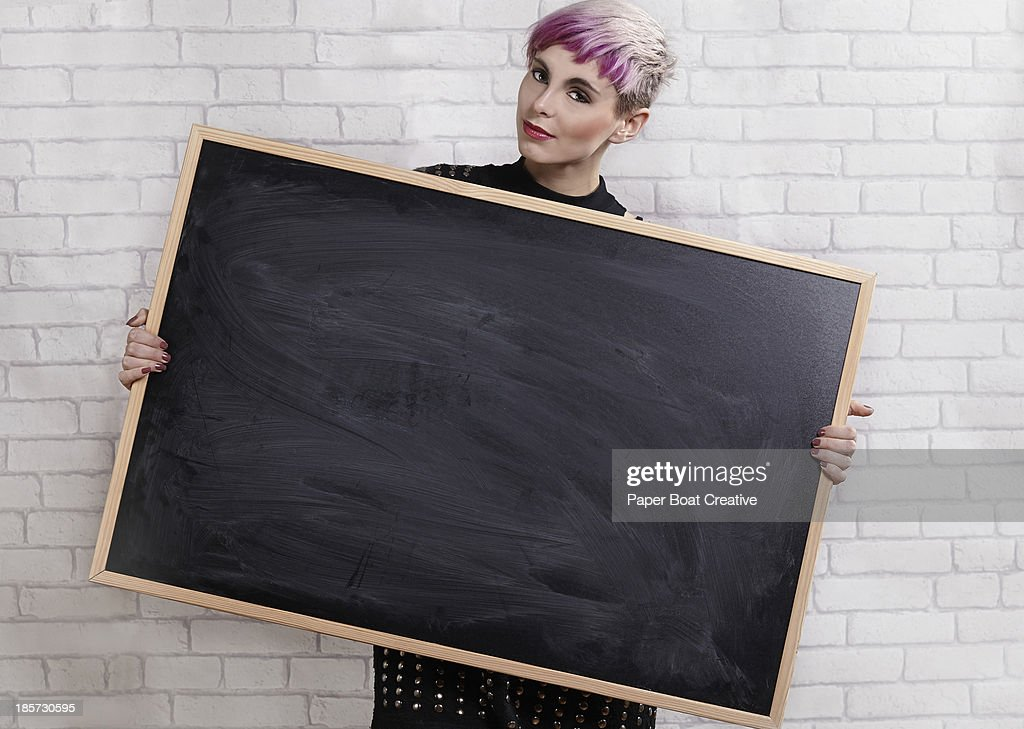 young designer holding a blank blackboard