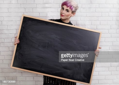 young designer holding a blank blackboard