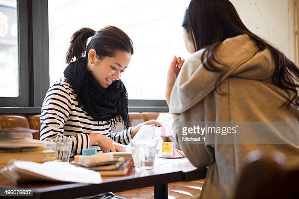 young designers discussing in cafe