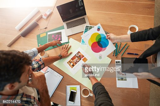 Young designers discussing the color palette : Stock Photo