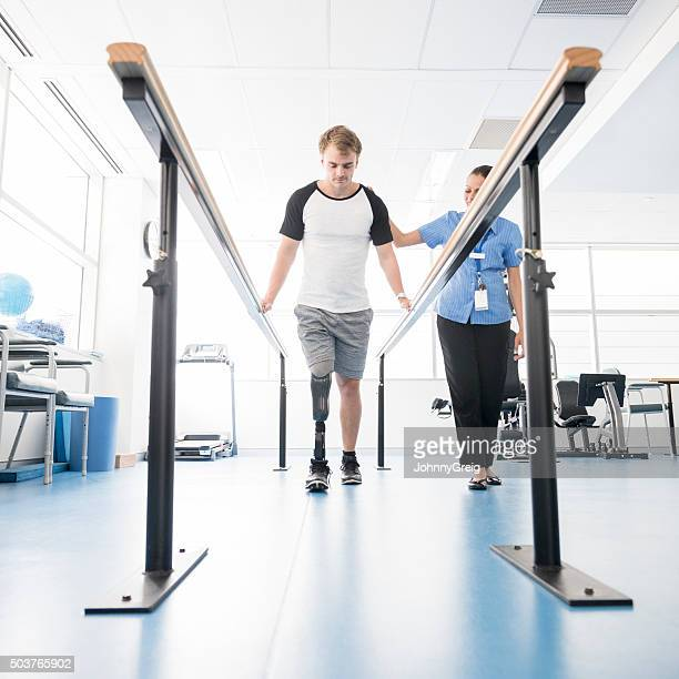 Young disabled man using orthopedic equipment to walk