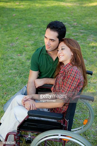 Young disabled woman with boyfriend