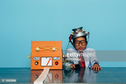 Young Dishonest Businessman with Lie Detector