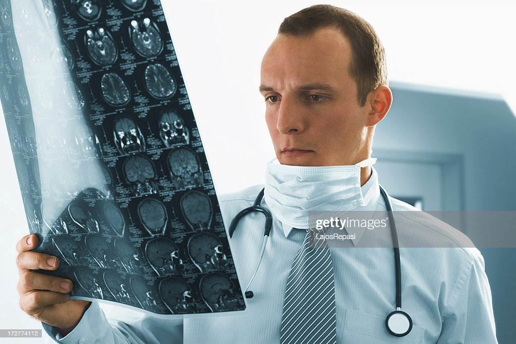 Young doctor checking an MR exposure