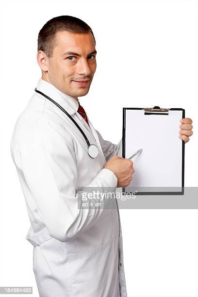 Young doctor showing something on blank page of notebook