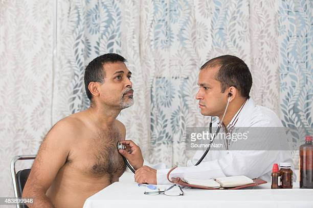 Young Doctor with a male patient doing a checkup