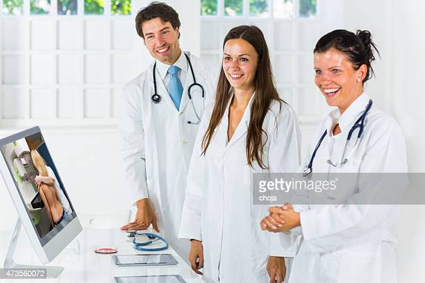 Young doctors  watching picture of mammography on computor monitor