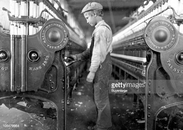 A young doffer boy works among the machines in a Lincolnton mill North Carolina 1908