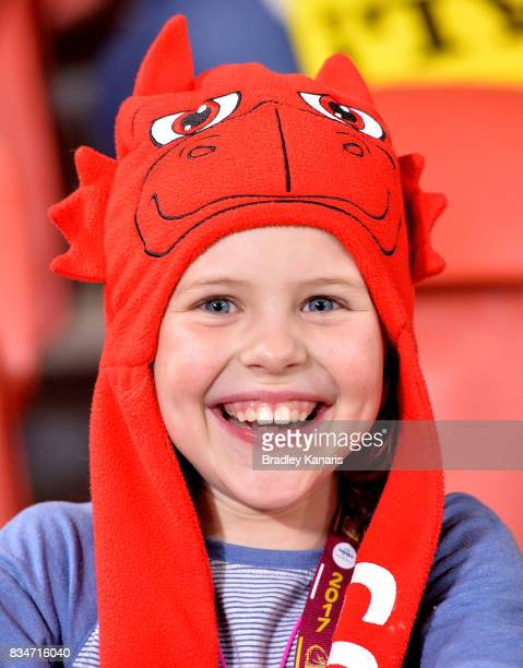 A young Dragons fan shows her support during the round 24 NRL match between the Brisbane Broncos and the St George Illawarra Dragons at Suncorp...