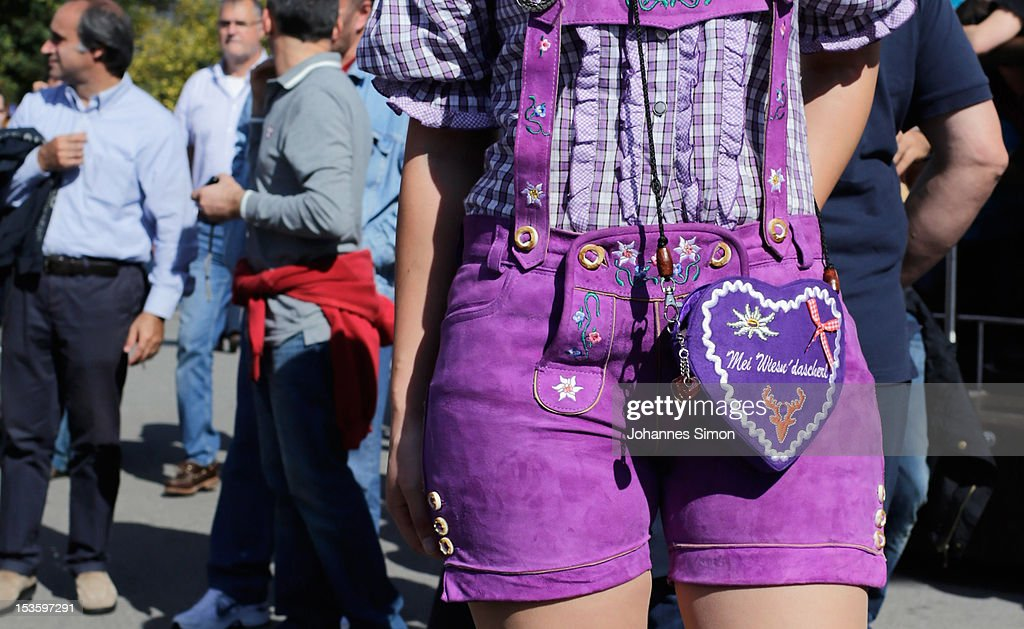 A young dressed in a kind of fancy Bavarian costume attends day 15 of Oktoberfest beer festival on October 6, 2012 in Munich, Germany. This year's edition of the world's biggest beer festival Oktoberfest will run until October 7, 2012.