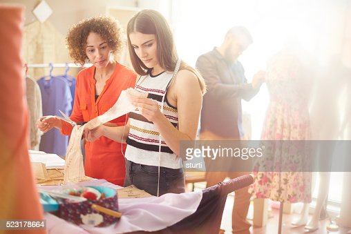 young dressmaker checking pattern