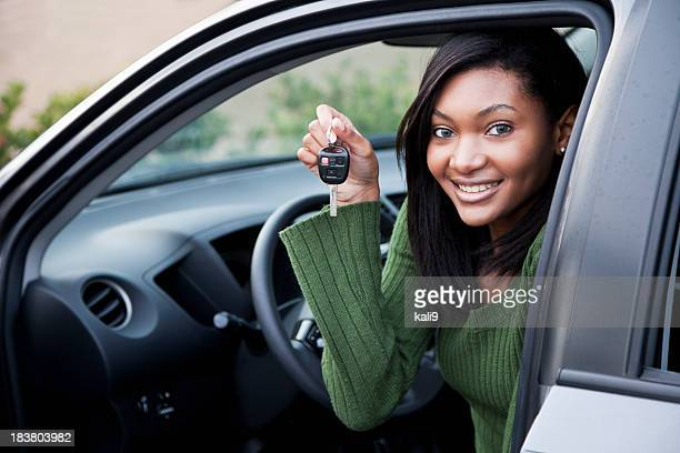 Young driver holding up car key