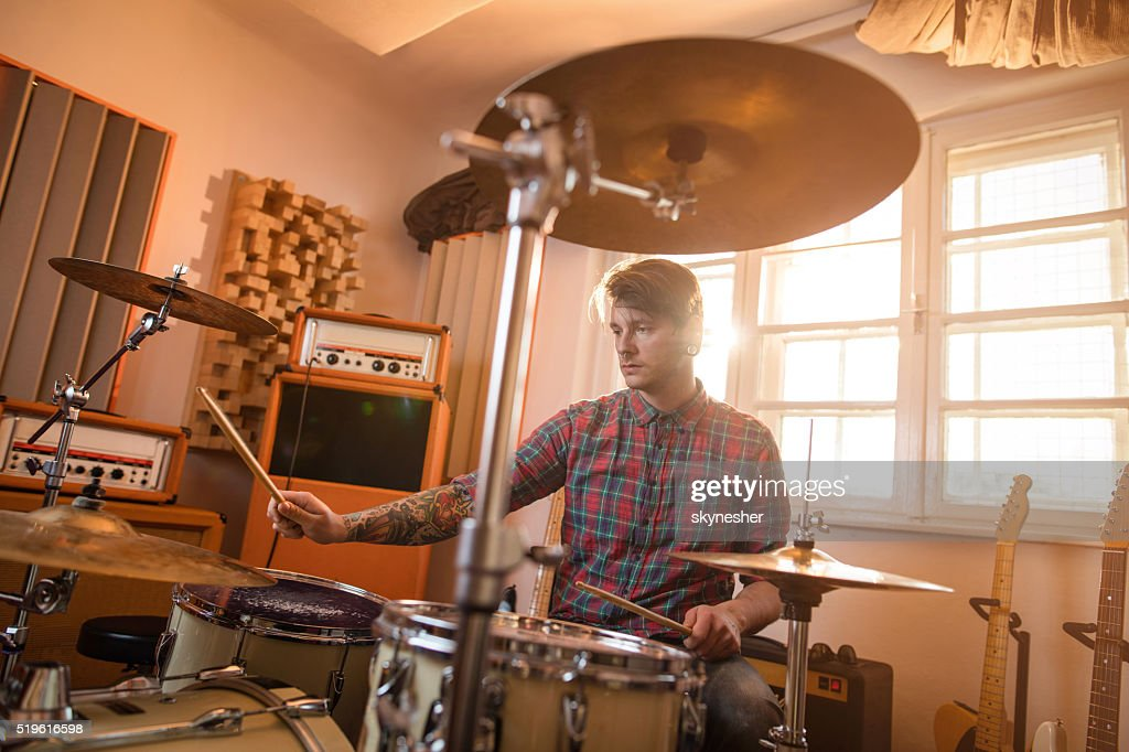 Young drummer in music studio playing drums. : Stock Photo