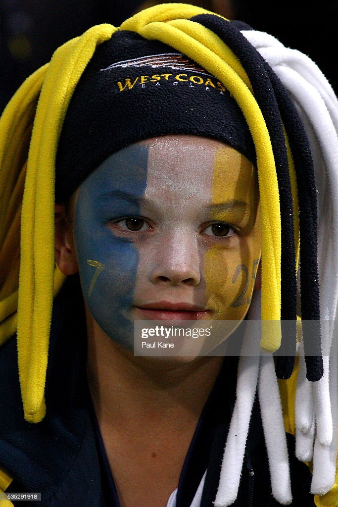 A young Eagles fan shows his support during the round 10 AFL match between the West Coast Eagles and the Gold Coast Suns at Domain Stadium on May 29, 2016 in Perth, Australia.
