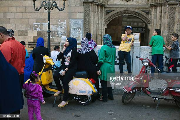 Young Egyptians wait in front of the Al Azhar Mosque during the festival of Eid al Adha or the Feast of the Sacrifice in the old city of Cairo on...