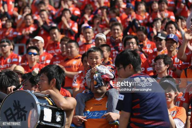A young Ehime FC supporter celebrates his team's 20 victory after the JLeague J2 match between Ehime FC and Montedio Yamagata at Nigineer Stadium on...
