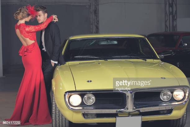 Young elegance couple at the retro car