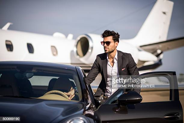 Young elegant man arriving at the airport track