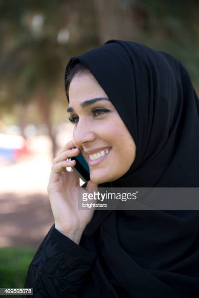 Young Emirati woman on the phone