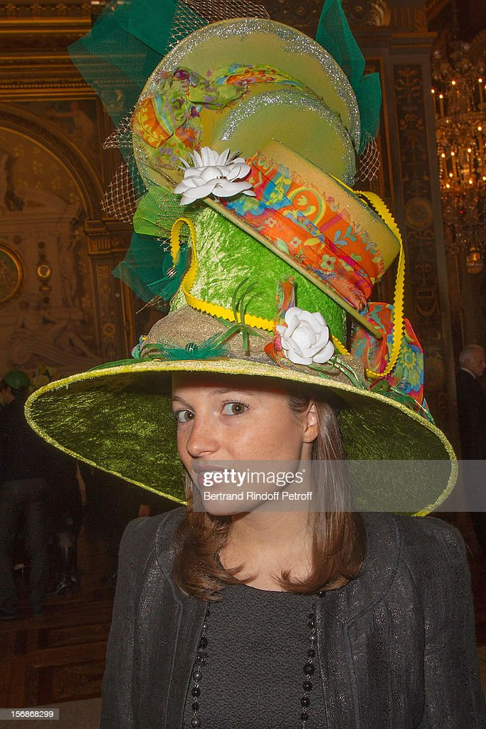 A young employee of the Chanel fashion house poses at the Paris City Hall during the Sainte-Catherine Celebration on November 23, 2012 in Paris, France.