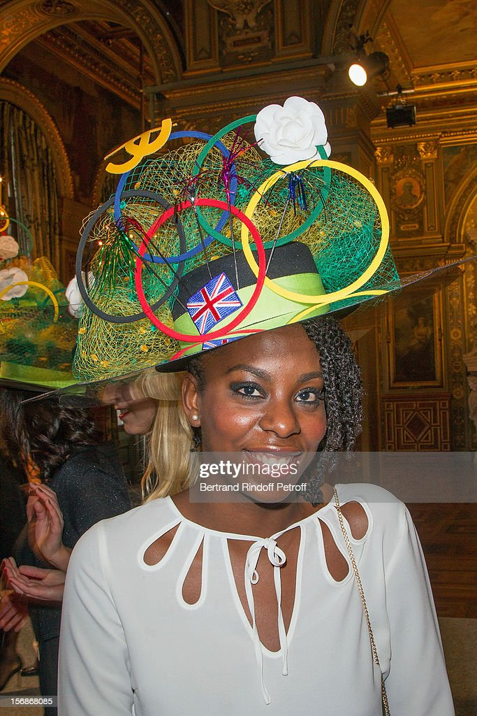 A young employee of the Chanel fashion house poses prior to parading at the Paris City Hall during the Sainte-Catherine Celebration on November 23, 2012 in Paris, France.