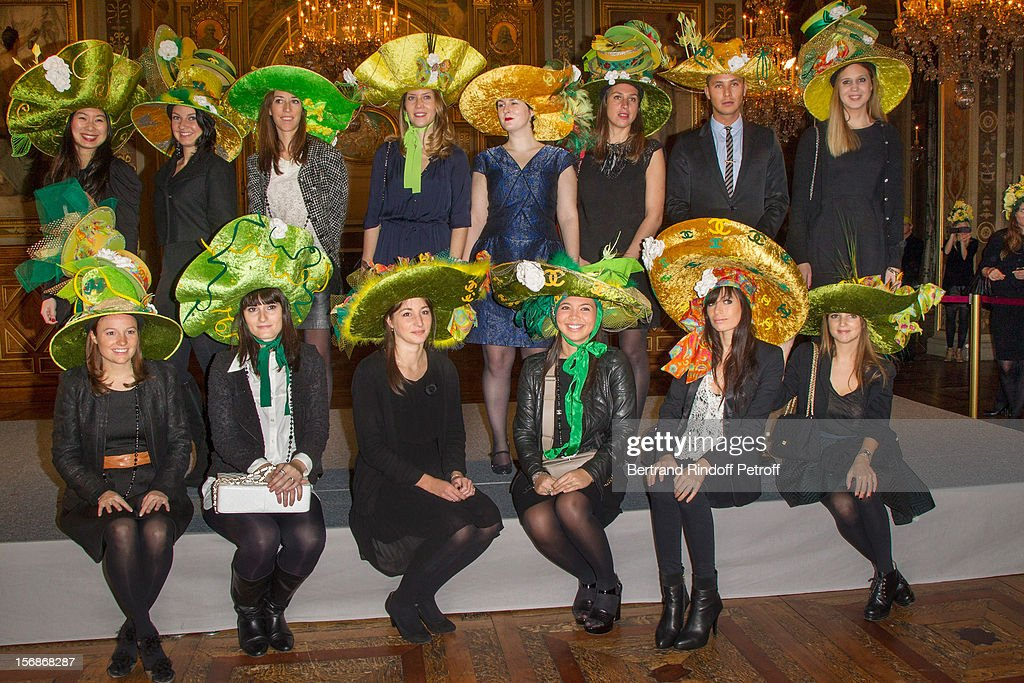 Young employees of the Chanel fashion house pose at the Paris City Hall during the Sainte-Catherine Celebration on November 23, 2012 in Paris, France.